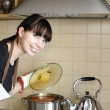 Young housewife preparing meal — Stock Photo
