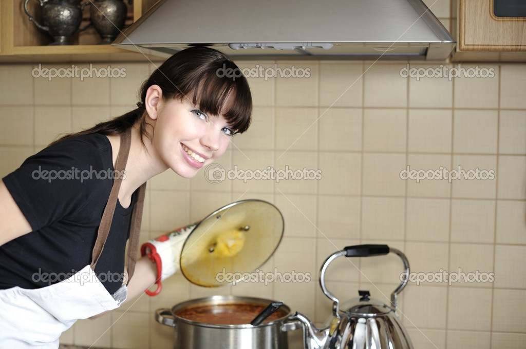 Young housewife preparing meal  Stock Photo #2692460