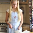 Young housewife cooking — Stock Photo