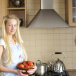 Young housewife in kitchen — Stock Photo