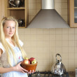 Young housewife posing in kitchen — Stock Photo