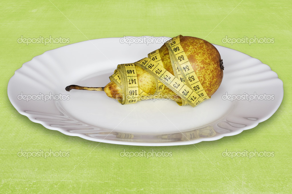 Healthy pear with measure tape,in a plate — Stock Photo #2698144
