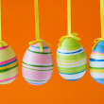 Easter eggs on orange background — Stock Photo
