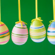 Stock Photo: Easter eggs on green background