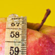 Stock Photo: Red apple and measuring tape