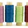 Royalty-Free Stock Photo: Four colorful thread spools
