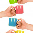 Four hands with colorful cups — Stock Photo