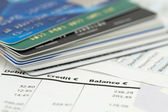 Credit cards on bank invoice — Stock Photo