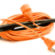 An orange extension cord — Stock Photo