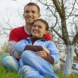 Young couple sitting on the grass — Stock Photo
