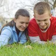 Couple lying on the grass — Stock Photo #2974412