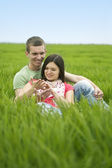 Couple lying on the grass — Stock Photo