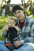 Father and baby looking at camera — Stock Photo