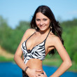 Girl with perfect body on the lake — Stock Photo
