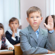 Schoolboy answer on question - Stock Photo