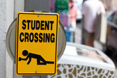 "Warning sign ""Drunken students crossing"" — Stock Photo"