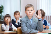Schoolboy answer on question — Stock Photo