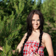 Beautiful woman in a forest — Stock Photo #3648433