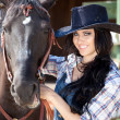 Cute cowgirl on ranch — Stock Photo #3648459