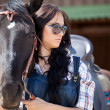 Cute cowgirl on ranch — Stock Photo #3648529