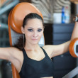 Girl in fitness hall — Stock Photo