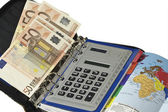 Notebook, money and the calculator — Stockfoto