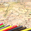 Color pencils on old map — Stock Photo #2830199