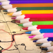 Stockfoto: Color pencils on old map