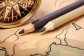 Compass and pencils on old map — Stock Photo