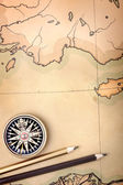 Compass and pencils on the map — Stock Photo