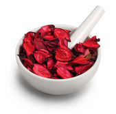 Mortar with dry rose petals — Stock Photo