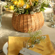 Festive table setting in yellow - Stock Photo