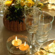 Table setting with candles - Stock Photo