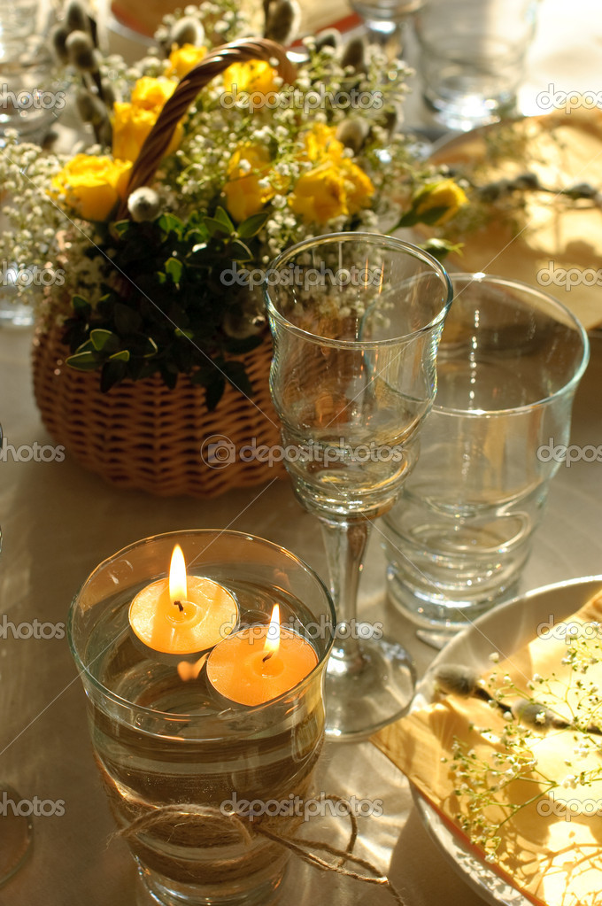 Festive table setting in yellow with candles on the foreground — Stock Photo #2770664
