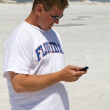 Man Texting At Beach — Stock Photo