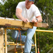 Stock Photo: Carpenter Checking Straight Line