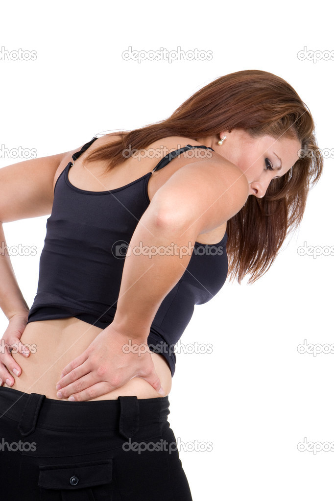 Woman bends over in pain rubbing her lower back as a result of a spinal injury accident. — Stock Photo #3486916