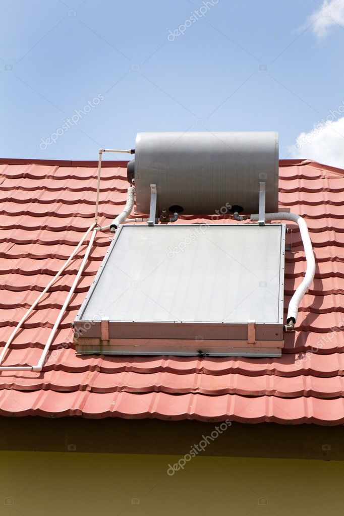 Solar water heater sits on the roof of a home in Manchester, Jamaica. — Stock Photo #3638060
