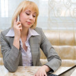 Blonde speaks on phone — Stock Photo