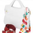 White ladies handbag with accessories — Stock Photo