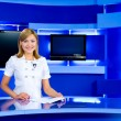 Stock Photo: Television anchorwoman at TV studio