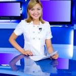 Television anchorwoman at TV studio — Stock Photo