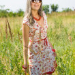 Happy girl in the field - Stock Photo