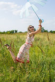 Happy girl in the field — Stok fotoğraf