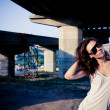 Glamour model near bridge - Stock Photo