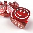 Dice with different emotions on faces — Stock Photo #4340264