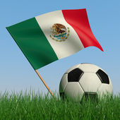 Soccer ball in the grass and the flag of Mexico — Stock Photo