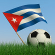 Soccer ball in the grass and the flag of Cuba — Stock Photo