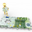 Men with euro from parts of puzzle — Stock Photo #5055535