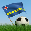 Soccer ball in the grass and the flag of Aruba — Stockfoto